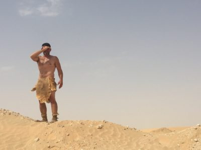 Bill in a loin cloth in the desert