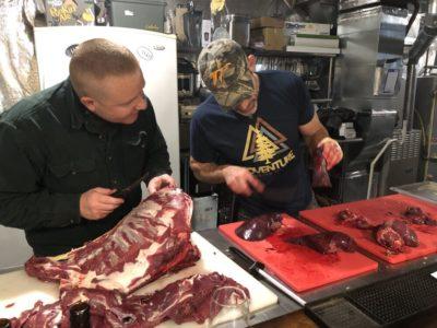 Teaching a friend how to butcher a deer