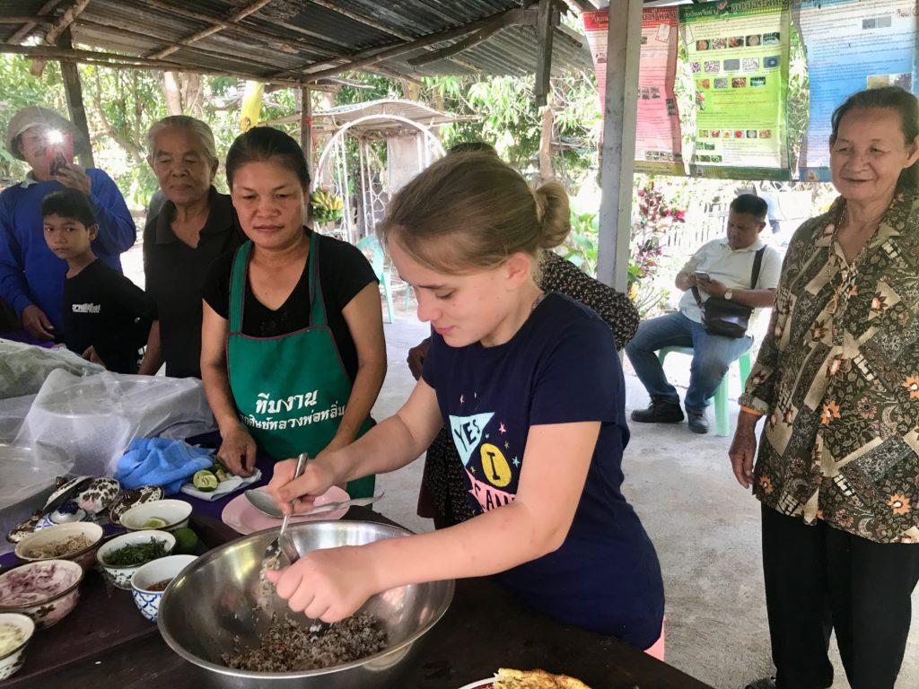 Alyssa cooking weaver ant eggs in Thailand