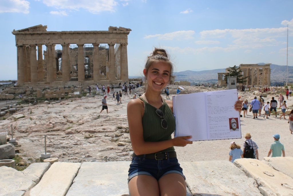 Brianna with her Classics notebook in Athens