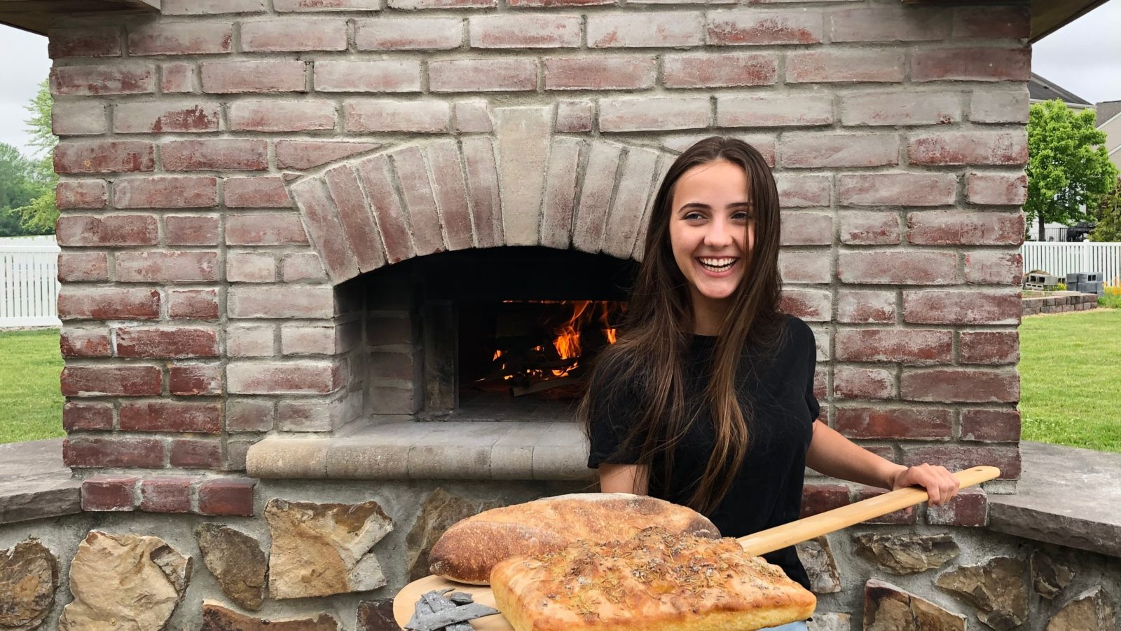 Brianna with her Rise bread in front of our oven